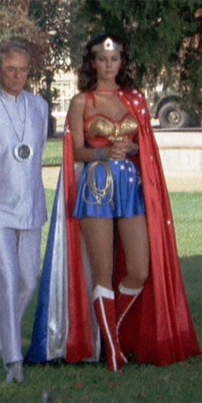 da4730f3da4af Wonder Woman can sport an awesome cape, too. Note her formal skirt, as  well, with retrained application of stars. We'll talk more about the skirt  below.